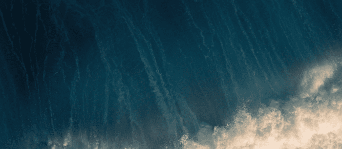 Wave crashing into shore