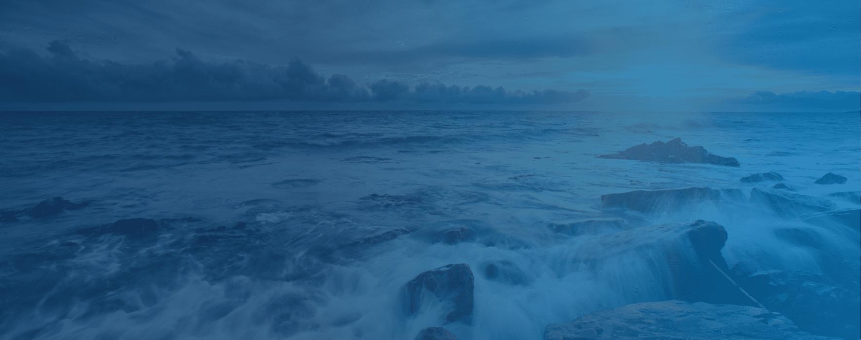 Wave crashing into a rocky shore