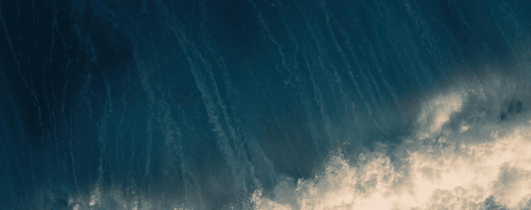 Ocean wave crashing into shore